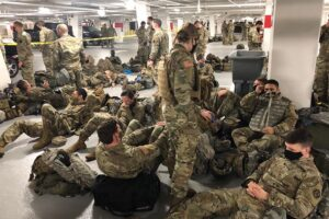 "OUTRAGE: Dems force National Guard troops who protected ""inauguration"" to sleep in the parking lot"
